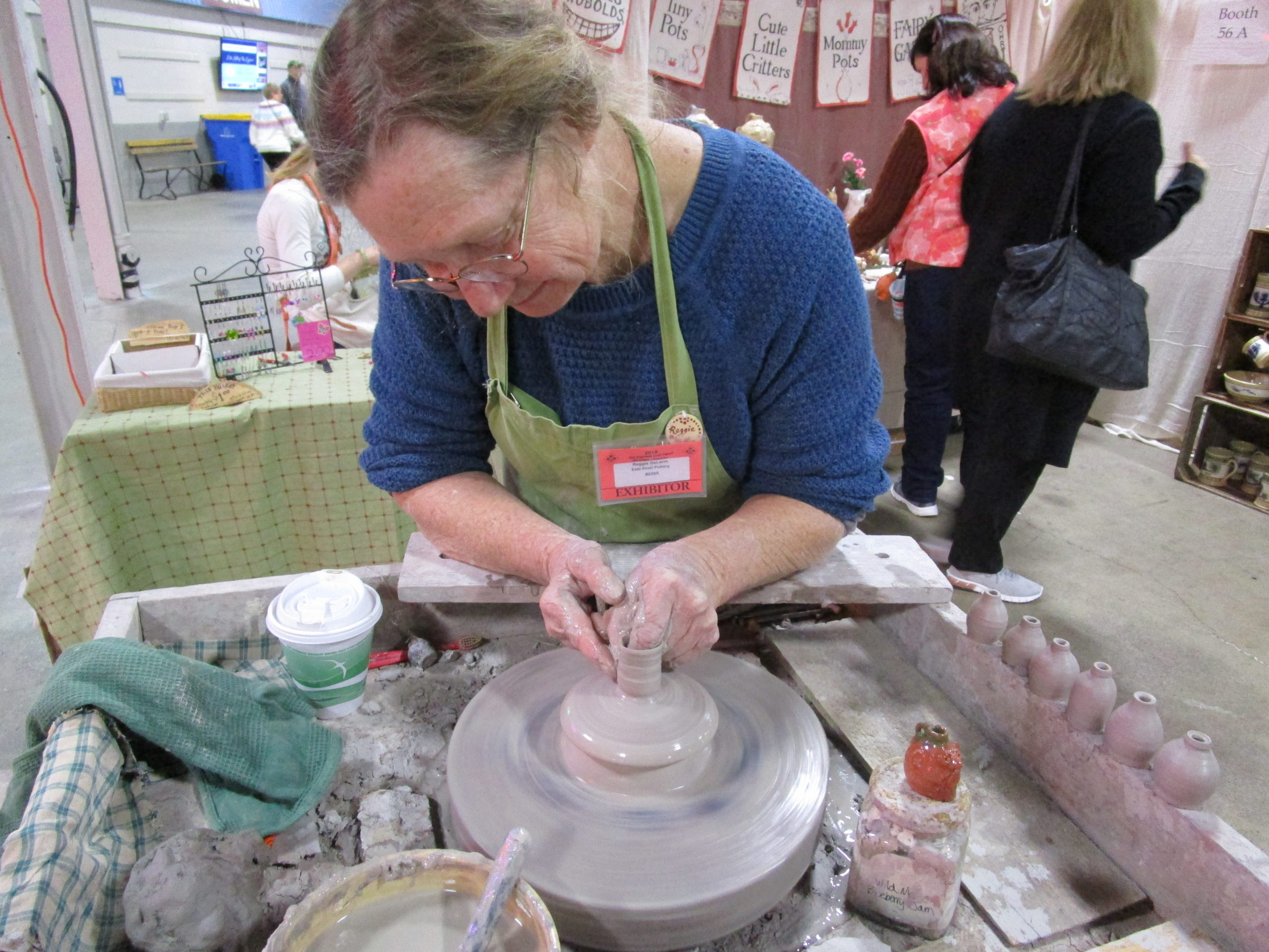 A potter works at one of the Old Deerfield Craft Fairs.