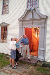 Checking out the features of an antique doorway in Historic Deerfield.