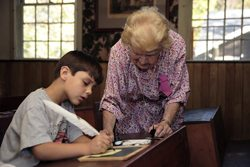 Learning to write with a quill pen at Historic Deerfield. Paul Shoul photo.