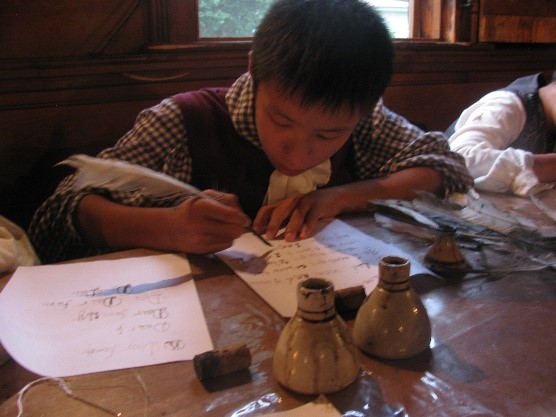 Writing with quill pen and walnut ink at PVMA.